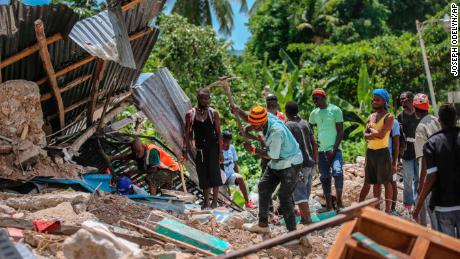Haiti death toll rises as tropical storm hits earthquake zone