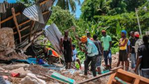 Search for victims in a home destroyed by an earthquake in Camp-Perrin, Les Cayes, Haiti, Aug. 15, 2021. The death toll from the magnitude 7.2 earthquake in Haiti soared on Sunday.