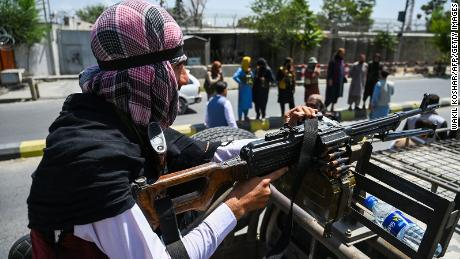 Taliban fighters patrol a street in Kabul on August 16, 2021.