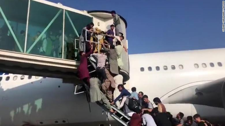 US temporarily suspends operations at Kabul airport as Afghans rush airfield