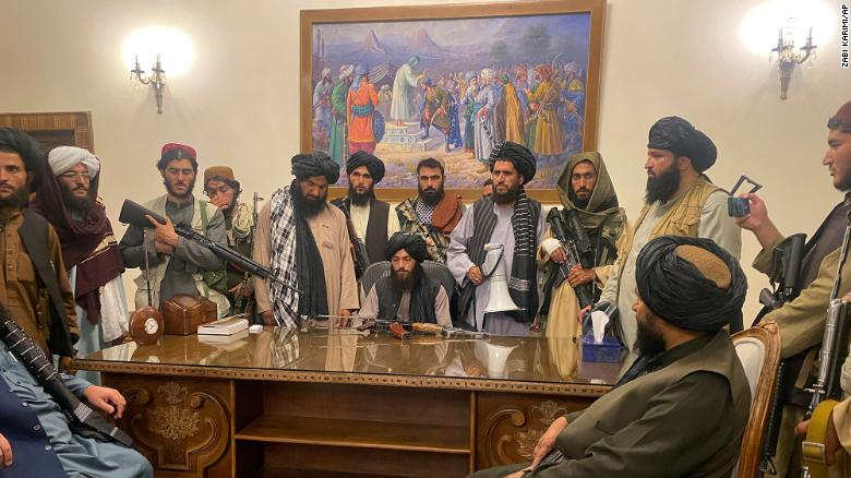 Taliban fighters take control of the Afghan presidential palace in Kabul, Afghanistan, on August 15, 2021.