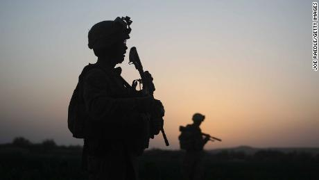 Silhouettes of US Marines are seen in 2009 in Herat, Afghanistan.