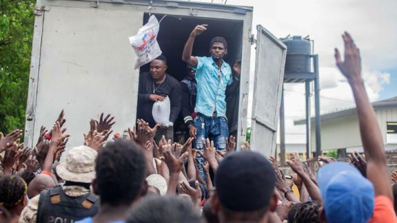 A crowd waits to receive humanitarian aid provided by the Fund for Economic and Social Assistance in Les Cayes.