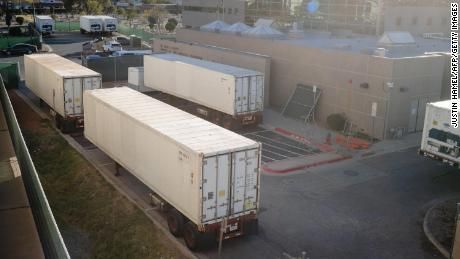 Refrigerated trailers serving as makeshift morgues are pictured outside of the El Paso County Medical Examiner's office in El Paso, Texas, on November 16, 2020. (Photo by Justin HAMEL / AFP) (Photo by JUSTIN HAMEL/AFP via Getty Images)