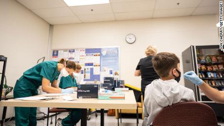 A student is administered a test during a Covid-19 testing day at Brandeis Elementary School on August 17, 2021, in Louisville, Kentucky.