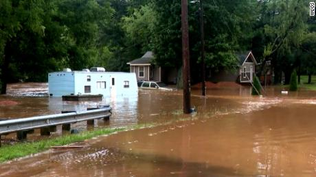 Crews rescue stranded drivers in Haywood County, North Carolina on Tuesday after flooding.