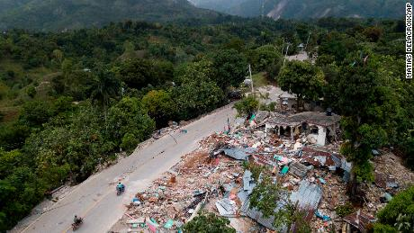 Homes lay in ruins along an earthquake-damaged road in Rampe, Haiti, on Aug. 18, 2021.
