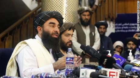 Spokesman Zabihullah Mujahid conducts the Taliban's first news conference since they seized power in Afghanistan.