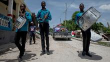 A funeral procession is held for an earthquake victim in L'Asile, Haiti, on Wednesday, August 18.
