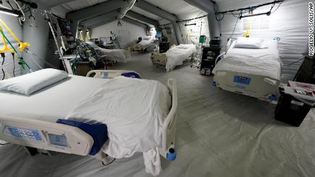 Five intensive care beds, part of the 32-bed Samaritan's Purse Emergency Field Hospital, are set up in a parking garage in Jackson, Miss.