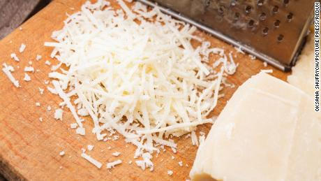 Time for the toppings -- how about grated Parmesan cheese?