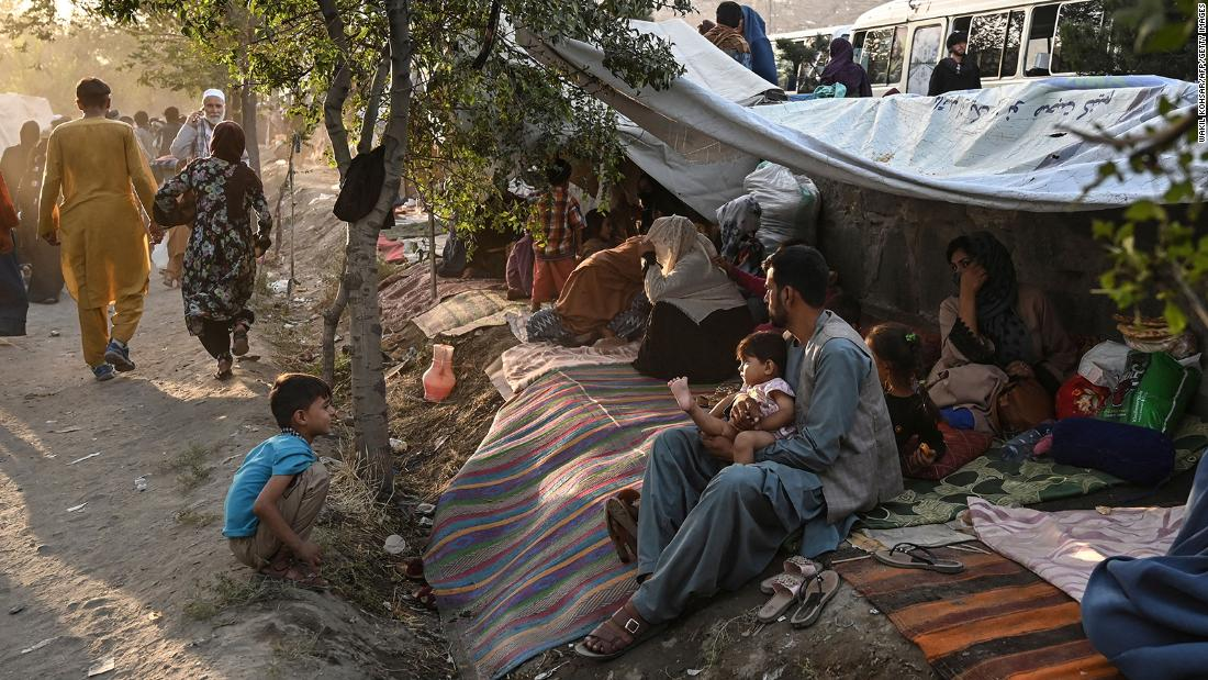 Internally displaced Afghan families, who fled from Kunduz, Takhar and Baghlan province due to fighting between the Taliban and Afghan security forces, are pictured in Kabul on August 11.
