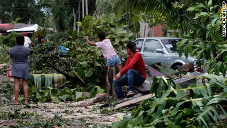 Residents remove debris from their homes after Hurricane Grace hit Tulum, Quintana Roo state, Mexico on Thursday, August 19, 2021.