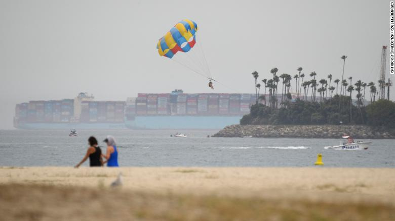 Container ships sit in the Pacific Ocean outside the Port of Long Beach, California on August 11, 2021.