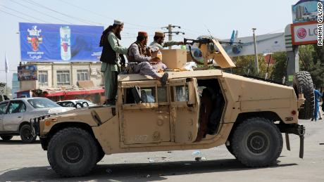 Taliban fighters in a Humvee  in Kabul on Monday, August 16, 2021.