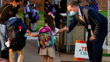 Oklahoma City Public School Superintendent Dr. Sean McDaniel punches students as they arrive at Rockwood Elementary School for Oklahoma City Public Schools on Monday, August 9, 2021, in Oklahoma City , Oklahoma.