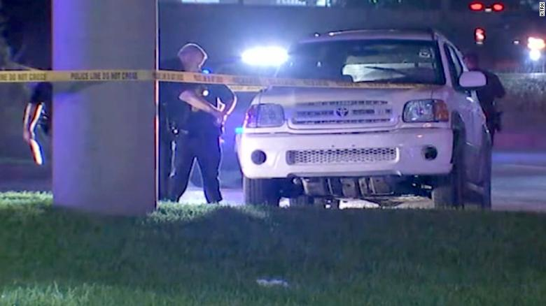 Two young boys steered their car to safety after their father was fatally shot while driving