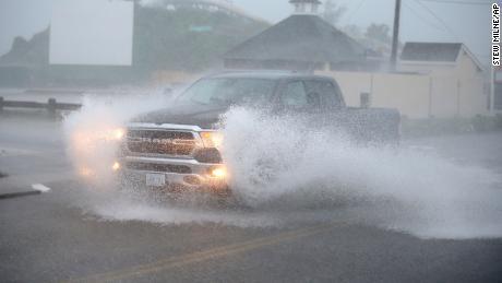 Slow-moving Tropical Storm Henri makes landfall along the coast of Rhode Island