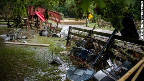Flood debris is strewn along Sam Hollow Road following heavy rains on Saturday August 21, 2021 in Dickson, Tennessee.