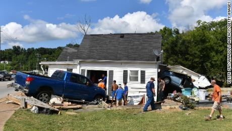 A damaged home is seen Sunday in Waverly, Tennessee.