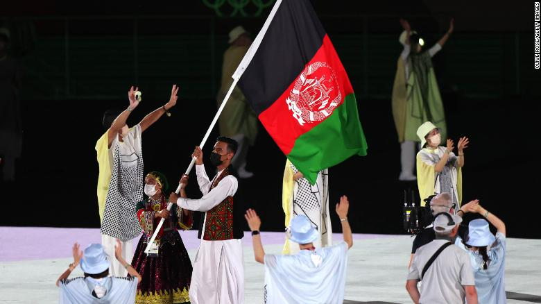 Flag bearers of Team Afghanistan during the Opening Ceremony of the Tokyo 2020 Olympic Games.