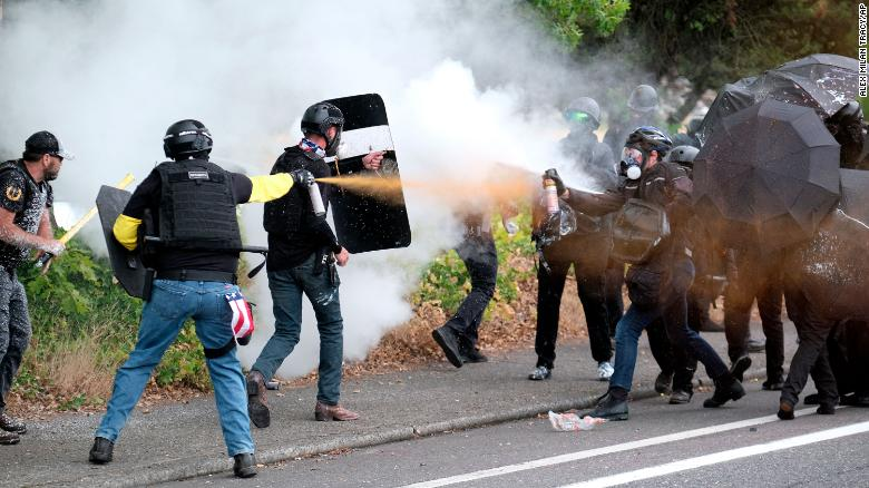 City defends hands-off policing after groups clash in Portland