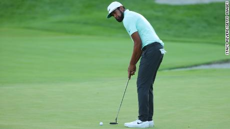 Finau putts on the first-playoff 18th hole at the Northern Trust.