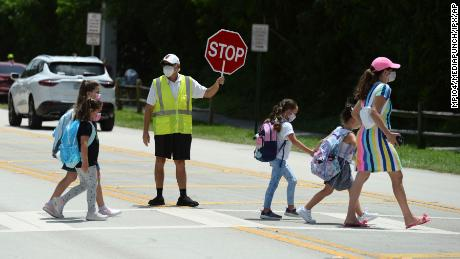 Two Florida counties double school mask terms, defying governor's order