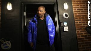 R. Kelly emerges from his studio before turning himself in to Chicago police on February 22, 2019.