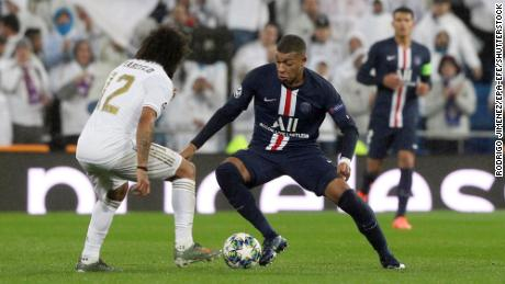Mbappe dribbles past Real Madrid's Marcelo during the  Champions League.