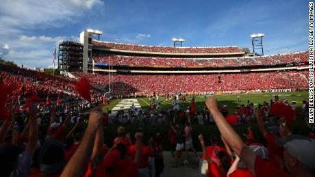 make states up the SEC have low vaccination rates, but stadiums will be 100% filled as a university football kicks off    this weekend