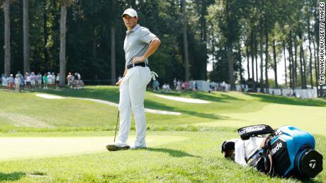 McIlroy looks on over the first green during the first round of the BMW Championship.