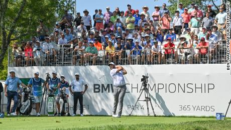 Rahm hits a shot on the first tee  during the first round of the BMW Championship.