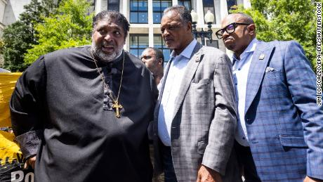 Mandatory Credit: Photo by JIM LO SCALZO/EPA-EFE/Shutterstock (12166650h) Political activists Reverend William J. Barber II (L) and Reverend Jesse Jackson (C) speak prior to being detained outside the Hart Senate Office Building for obstructing traffic during a 'Moral March on Manchin and McConnell' in Washington, DC, USA, 23 June 2021. Manchin, McConnell Protest in DC, Washington, USA - 23 Jun 2021