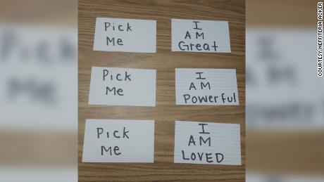 When students can't think of any affirmations, Neffiteria Acker offers them cards with positive messages written on them.