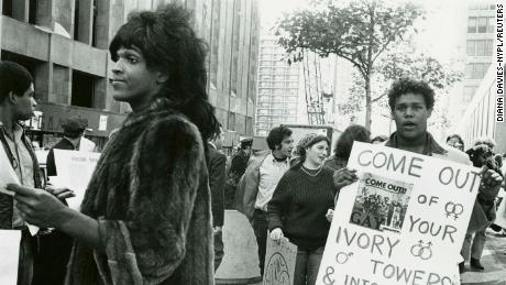 """A 1970 photo of Marsha P. Johnson handing out flyers in support of Gay Students at NYU is seen here courtesy of the New York Public Library's """"1969: The Year of Gay Liberation"""" exhibit."""