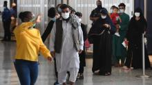 Afghan refugees arrive at Dulles International Airport on Friday in Dulles, Virginia, after being evacuated from Kabul following the Taliban takeover of Afghanistan.