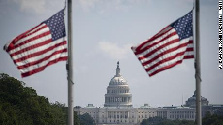 American flags fly at half staff on August 27 near the US Capitol following the deaths of 13 members of the US military in Thursday's attack at the airport in Kabul, Afghanistan.