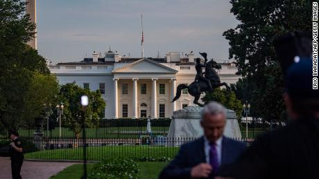 The US flag flies at half staff on August 26 over the White House.