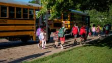 Students arrive for their first day of school on Wednesday, Aug. 25, 2021 at Westlake Elementary School in Battle Creek, Michigan.