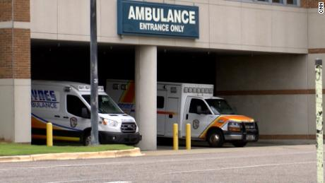 Ambulances await at a hospital in Montgomery, Alabama, as the state grapples with the latest coronavirus surge.