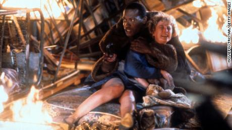 """Tony Todd holds onto Virginia Madsen in a scene from original """"Candyman"""" film in 1992."""
