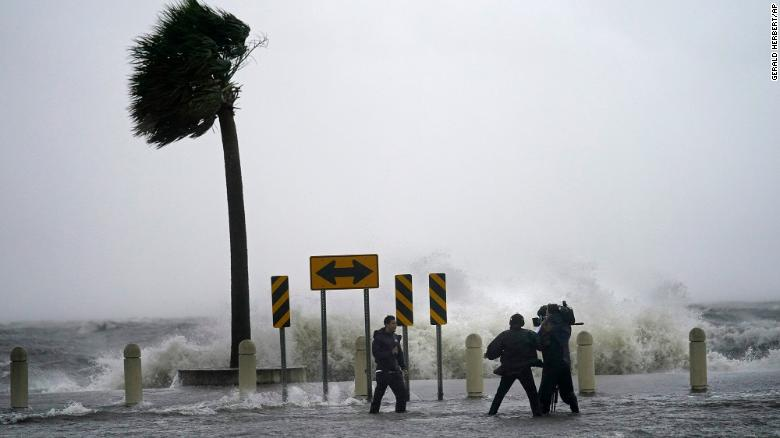 A news crew reports on the edge of Lake Pontchartrain ahead of approaching Hurricane Ida in New Orleans, Sunday, Aug. 29, 2021.