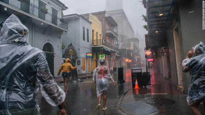 A group of people walk through the French District during Hurricane Ida on August 29, 2021 in New Orleans, Louisiana.