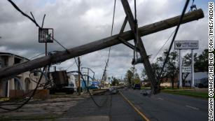 A downed utility pole blocks part of a roadway in Houma, Louisiana, on August 30  after Hurricane Ida swept through the region.