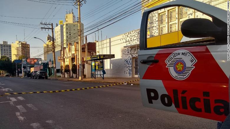 Hostages strapped to getaway cars as robbers target banks in Brazil