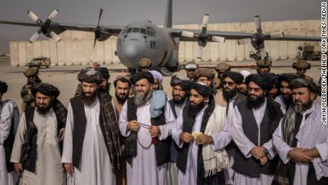 Taliban officials, including Zabihullah Mujahid, third from right, announcing victory at the airport in Kabul, Afghanistan, on Tuesday, Aug. 31, 2021. Afghans woke up Tuesday morning to the reality of an Afghanistan firmly under the control of the Taliban amid intensifying fears that their country was being subsumed by a repressive regime as it battles an escalating economic and humanitarian crisis. (Jim Huylebroek/The New York Times)