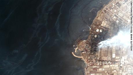 An aerial image provided by Maxar showing oil pooling around the power plant in Baniyas, Syria.
