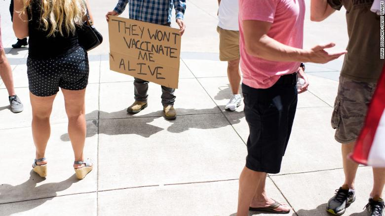 Anti-vaccine rally protesters hold signs outside of Houston Methodist Hospital in Houston, Texas, on June 26, 2021.