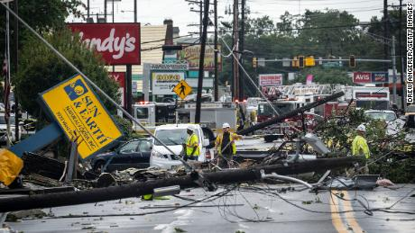 Comcast utility workers examine tornado damage on West Street in Annapolis, Maryland.